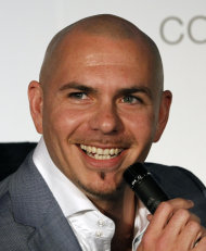 "FILE - This April 25, 2012 file photo shows Miami rapper Pitbull during an interview in Miami. It's official. Pitbull will be coming to Alaska. Over the last few weeks, Walmart has been running a marketing contest on its Facebook page. The store that got the most ""likes"" wins a personal appearance from Pitbull, aka Miami rapper Armando Christian Perez. A writer for The Boston Phoenix newspaper thought it'd be funny to send Pitbull to the most remote Walmart possible, and encouraged people to pick the Walmart in Kodiak _ which wound up with more than 70,000 ""likes."" (AP Photo/Alan Diaz, File)"