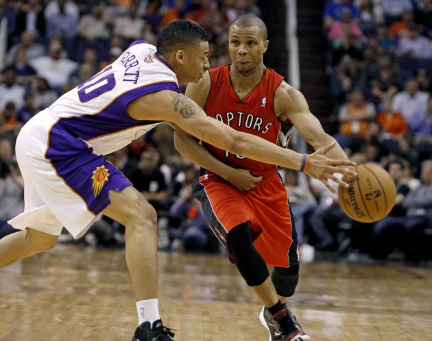 Suns' Diante Garrett tries to steal the ball from Raptors' Sebastian Telfair during their NBA basketball game in Phoenix