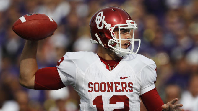 Oklahoma quarterback Landry Jones (12) passes during the first half of an NCAA college football game against Kansas State Saturday, Oct. 29, 2011, in Manhattan, Kan. (AP Photo/Orlin Wagner)