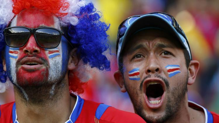 Costa Rica fans wait for the start of their 2014 World Cup round of 16 game against Greece at the Pernambuco arena in Recife