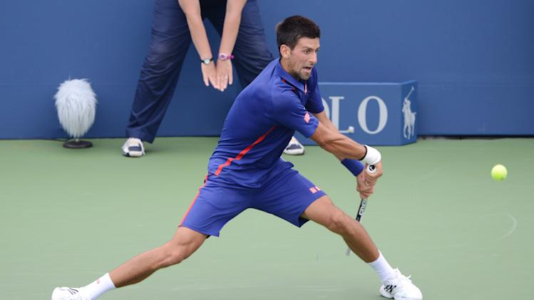 Novak Djokovic of Serbia stretches to return a shot during his win over Switzerland's Stanislas Wawrinka in the quarterfinals round of play at the 2012 US Open tennis tournament,  Wednesday, Sept. 5, 2012, in New York. (AP Photo/Henny Ray Abrams)