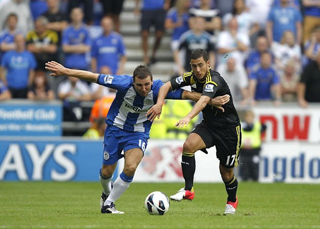 Eden Hazard, right, set up both Chelsea goals against Wigan