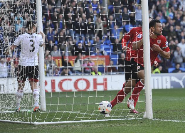 Cardiff City's captain Caulker celebrates scoring a goal against Fulham, during their English Premier League match in Cardiff