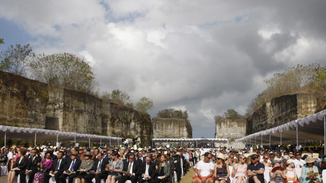 People attend a memorial service marking the 10th anniversary of the 2002 Bali bombings terrorist attacks at nightclubs in Kuta that killed 202 people, including 88 Australians and seven Americans, in Jimbaran in Bali, Indonesia, Friday, Oct. 12, 2012. (AP Photo/Made Nagi, Pool)