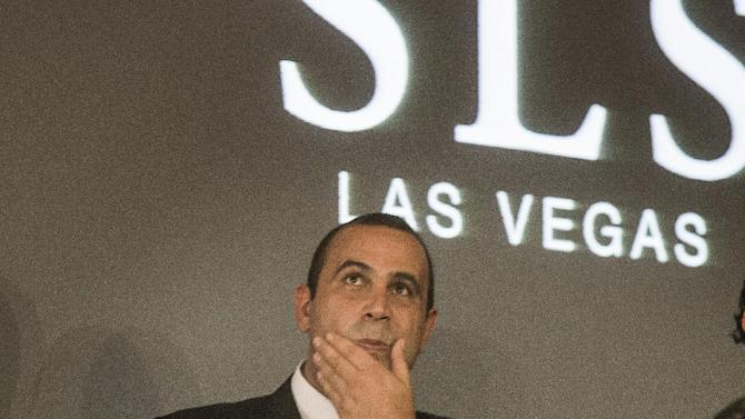 This Aug. 22, 2014 photo shows, Sam Nazarian, CEO of SBE Entertainment, during the ceremonial ringing of the bell at SLS Las Vegas. The Los Angeles nightlife entrepreneur who recently revamped the Sahara Hotel and Casino on the Las Vegas Strip into a hipper, sleeker destination is facing another interrogation into past misdeeds as he seeks a Nevada gambling license. Nazarian is scheduled to appear before Nevada's Gaming Commission on Thursday, Dec. 18, 2014. (AP Photo/Las Vegas Review-Journal, Jeff Scheid)