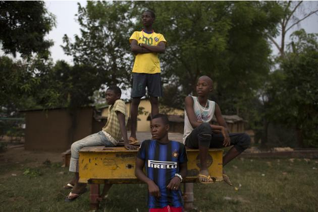 Boys watch a football match in Bangui