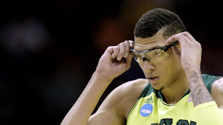 Baylor's Isaiah Austin adjusts his glasses during the first half of a second-round game against Nebraska in the NCAA college basketball tournament Friday, March 21, 2014, in San Antonio