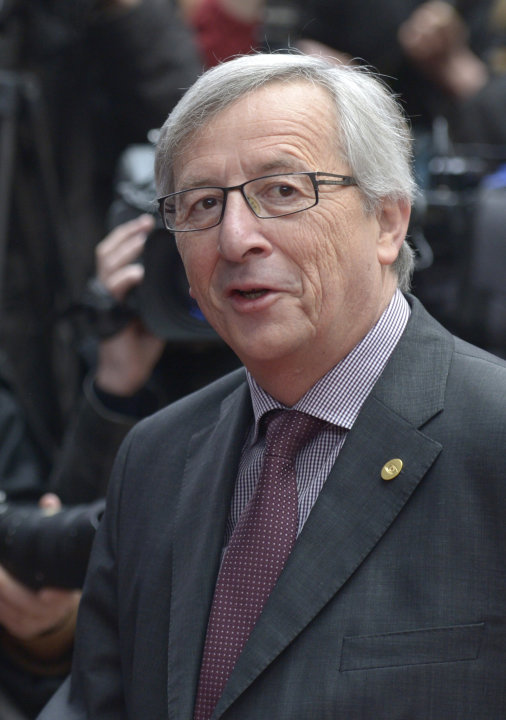 Luxembourg's Prime Minister Jean-Claude Juncker passes the media upon arrival at an EU summit in Brussels on Wednesday, May 22, 2013. Leaders from the 27 European Union countries gather in Brussels fo