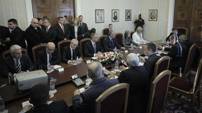 Bulgarian officials attend the Consultative Council meeting on National Security at the Bulgarian President's office in Sofia, Tuesday, Feb. 5, 2013.  Investigators are releasing a summary of their findings to the Bulgarian government Tuesday, which is widely expected to link the militant group Hezbollah to the bus bomb attack on July 18, 2012, that killed five Israeli tourists in the coastal city of Burgas, Bulgaria. (AP Photo/Valentina Petrova)