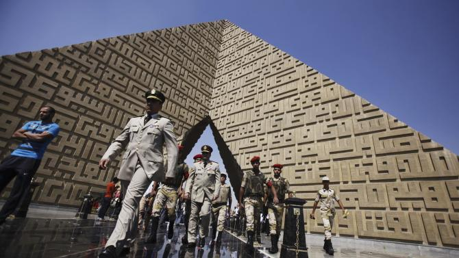 Members of the army walk at the tomb of late President Sadat during the 40th anniversary of Egypt's attack on Israeli forces in the 1973 war, in Cairo