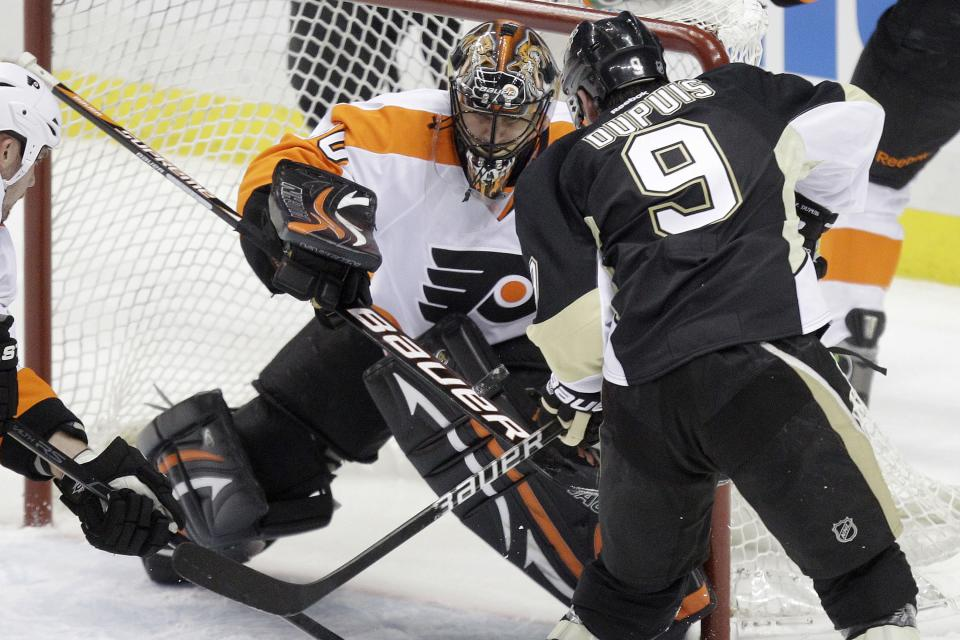 Pittsburgh Penguins' Pascal Dupuis (9) wrists his first-period goal past Philadelphia Flyers goalie IIya Bryzgalov during Game 1 of an opening-round NHL hockey playoff series Wednesday, April 11, 2012, in Pittsburgh. (AP Photo/Gene J. Puskar)
