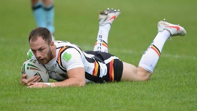 Bradford Bulls' Luke Gale dives in to score a try