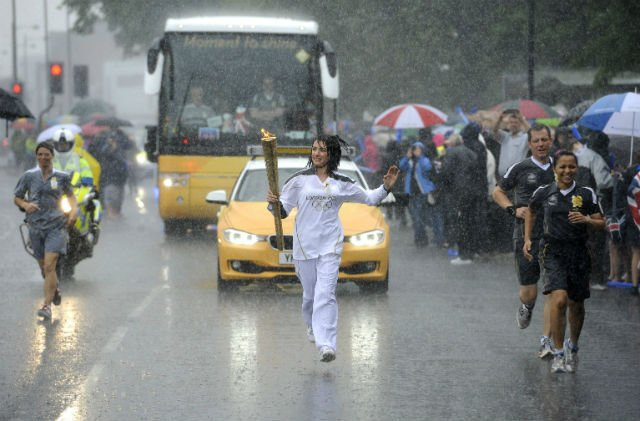 Gemma Flaxman carries the Olympic Flame