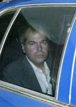 FILE - In a Nov. 18, 2003 file photo, John Hinckley Jr. arrives at U.S. District Court in Washington. Hinckley, the man who shot President Ronald Reagan is back in court for hearings on whether he should get to spend more time away from the psychiatric hospital where he has been living. (AP Photo/Evan Vucci, File)