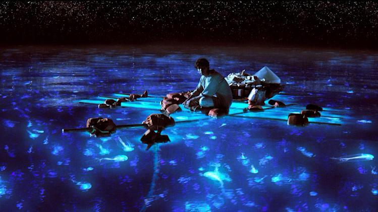 "This publicity photo released by 20th Century Fox shows Suraj Sharma as Pi Patel taking in the bioluminescent wonders of the sea in a scene from the film, ""Life of Pi."" With 11 Academy Awards nominations, second only to ""Lincoln"" with 12, and the sort of global box-office receipts normally reserved for superheroes, ""Life of Pi"" is one of the most unusual megahits ever to hit the big-screen.  (AP Photo/20th Century Fox)"
