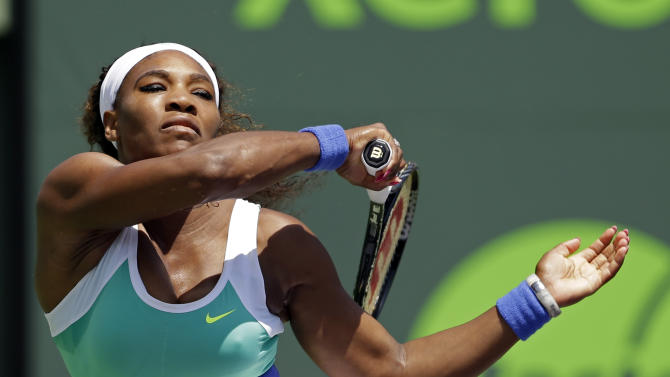 Serena Williams, of the United States, follows through on a return to Li Na, of China, during the Sony Open tennis tournament in Key Biscayne, Fla., Tuesday, March 26, 2013. (AP Photo/Alan Diaz)