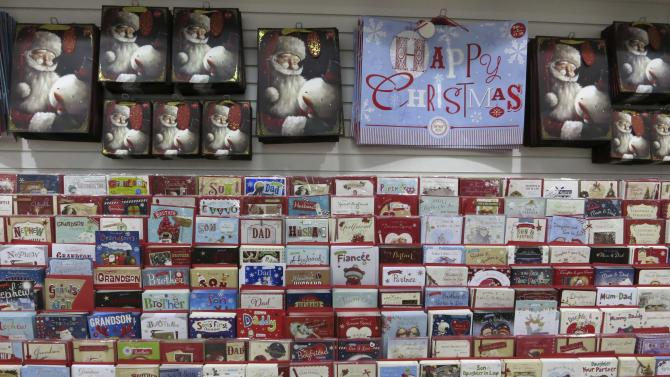 Christmas cards, wrapping and bags are seen for sale in Westgate shopping centre in east London