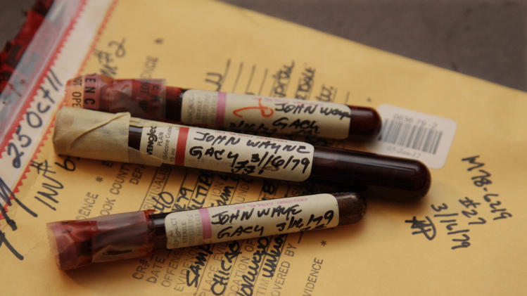 This photo taken Friday, Nov. 30, 2012, in Chicago shows three vials of mass murderer John Wayne Gacy's blood recently discovered by Cook County Sheriff's detective Jason Moran. The sheriff's office is creating DNA profiles from the blood of Gacy and other executed killers and putting them in a national DNA database of profiles created from blood, semen, or strands of hair found at crime scenes and on the bodies of victims. What they hope to find is evidence that links the long-dead killers to the coldest of cold cases and prompt authorities in other states to submit the DNA of their own executed inmates and maybe evidence from decades-old crime scenes to help them solve their own cases. (AP Photo/M. Spencer Green)