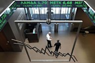 Employees walk at Athens stock exchange. World stock markets initially rallied in reaction to Sunday's elections and the euro rose sharply against the dollar but the gains quickly petered out amid broader concerns about other indebted euro economies like Italy and Spain