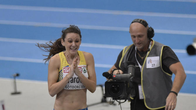 A cameraman films Sweden's Erica Jarder reacting after winning bronze in the women's long jump during the Athletics Indoors European Championships in Gothenburg, Sweden, Saturday, March 2, 2013. (AP Photo/Martin Meissner)