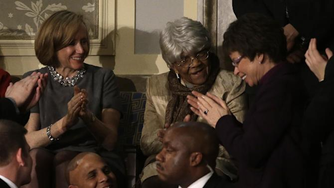Desiline Victor, 102, of Miami is applauded by White House senior adviser Valerie Jarrett, right, and others, during President Barack Obama's State of the Union address during a joint session of Congress on Capitol Hill in Washington, Tuesday Feb. 12, 2013. (AP Photo/Jacquelyn Martin)