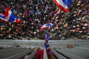 Anti-government protesters gather outside the Royal Thai Police headquarters during a rally in central Bangkok