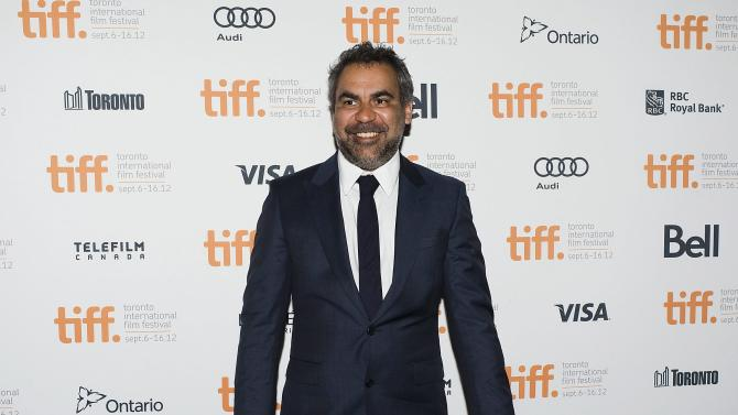 "FILE - In this Sept. 9, 2012 file photo, director Wayne Blair poses for a photo on the red carpet at the Elgin Theatre for his film ""The Sapphires"" during the 2012 Toronto International Film Festival in Toronto. Feel-good musical drama ""The Sapphires"" sparkled at Australia's premier film awards.  The tale of an Aboriginal family singing group entertaining American troops in the Vietnam War won best film and five other awards at the Australian Academy of Cinema and Television Arts ceremony Wednesday night, Jan. 30, 2013. (AP Photo/The Canadian Press, Aaron Vincent Elkaim, File)"
