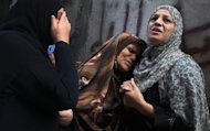 The mother (centre) of Palestinian Hamas militant Ismail al-Tili mourns during his funeral in Beit Lahia, Gaza, on October 24 after he was killed in an Israeli air raid. Tensions have been high in and around the Gaza border for the past few weeks, but peaked early on Tuesday when an Israeli soldier was severely injured by a roadside bomb by the fence in central Gaza