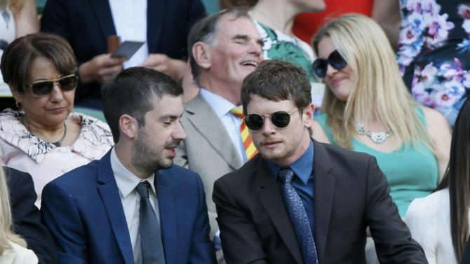 Actor Jack O'Connell (R) watches the action on Centre Court at the Wimbledon Tennis Championships in London