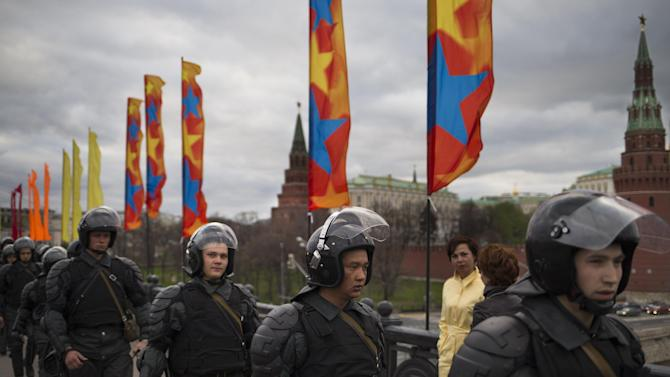 Russian riot police secure an area outside the Kremlin during a major protest rally in Bolotnaya Square in Moscow, Russia, Monday May 6, 2013. The rally marks the one-year anniversary of a protest on the eve of Putin's inauguration that ended in clashes between police and demonstrators. (AP Photo/Alexander Zemlianichenko)