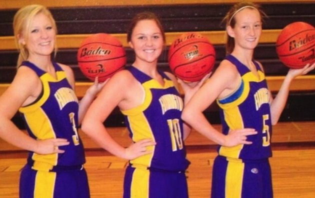 "Three Farmington (Ill.) High seniors appear to flash ""the shocker"" in this basketball photo -- Twitter"