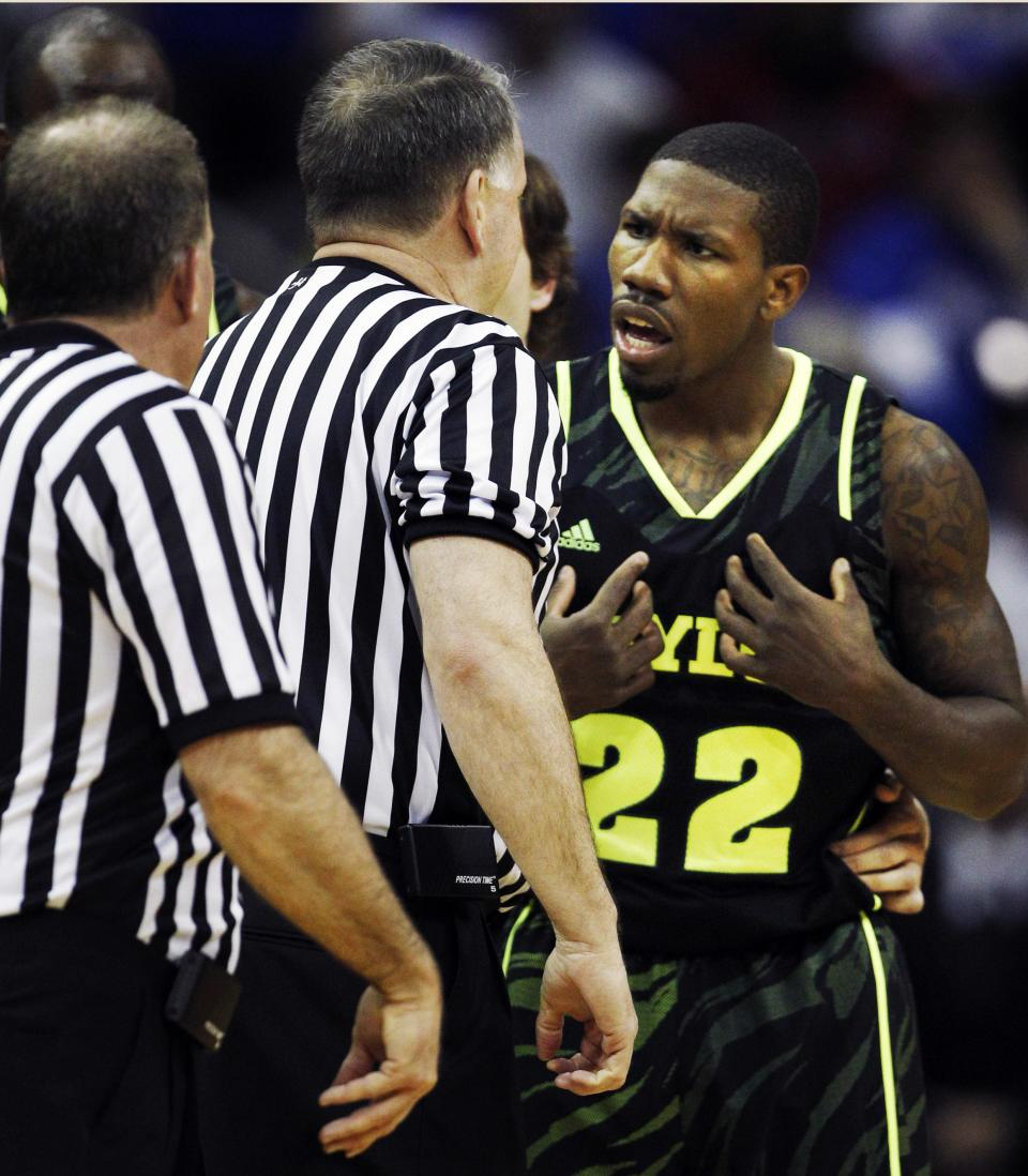 Baylor guard A.J. Walton (22) talks officials after being called for a technical foul during the first half of an NCAA college basketball game against Kansas in the Big 12 Conference tournament on Friday, March 9, 2012, in Kansas City, Mo. (AP Photo/Orlin Wagner)
