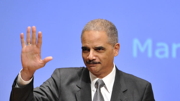 "Attorney General Eric Holder waves to the audience as he is introduced before speaking at the Northwestern University law school, Monday, March 5, 2012 in Chicago. Holder said Monday that the decision to kill a U.S. citizen living abroad who poses a terrorist threat ""is among the gravest that government leaders can face,"" but justified lethal action as legal and sometimes necessary in the war on terror. (AP Photo/Brian Kersey)"