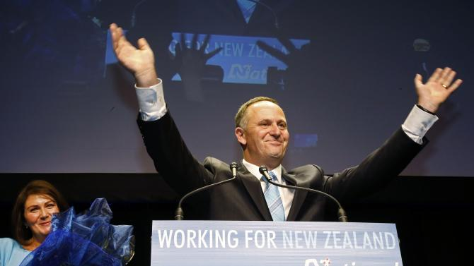 New Zealand's National Party leader and Prime Minister-elect John Key celebrates a landslide victory at the National election party during New Zealand's general election in Auckland