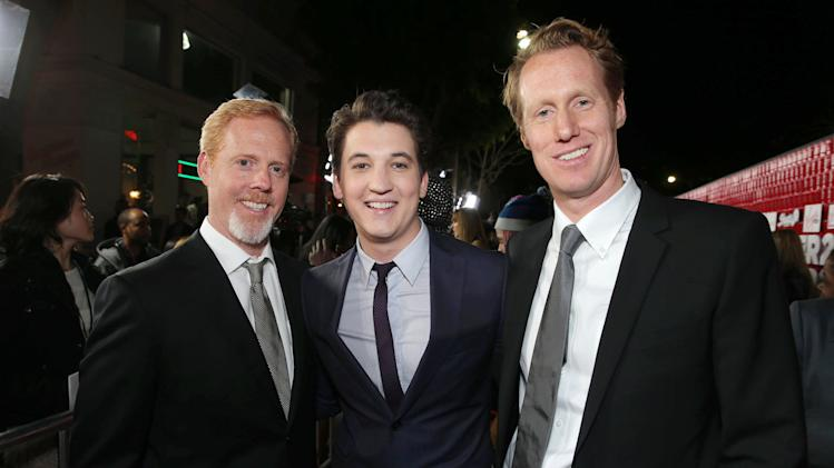 "Director/Writer Scott Moore, Miles Teller and Director/Writer Jon Lucas arrive at the LA premiere of ""21 and Over"" at the Westwood Village Theatre on Thursday, Feb. 21, 2013 in Los Angeles. (Photo by Eric Charbonneau/Invision/AP)"