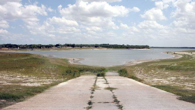 This photo taken Friday, June 15, 2012 shows the water levels of Lake Corpus Christi near Mathis, Texas. Lake levels at Lake Corpus Christi have dropped considerably in just the last few month that the city of Corpsu Christi is think of mandatory water conservation restrictions which could be in place by mid-September unless Corpus Christi's lakes receive rain. (AP Photo/Corpus Christi Caller-Times, Todd Yates)