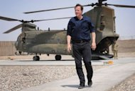 British Prime Minister David Cameron arrives by helicopter in Lashkar Gah in Afghanistan's Helmand Province. Cameron visited frontline troops at the start of his visit to Afghanistan on Wednesday