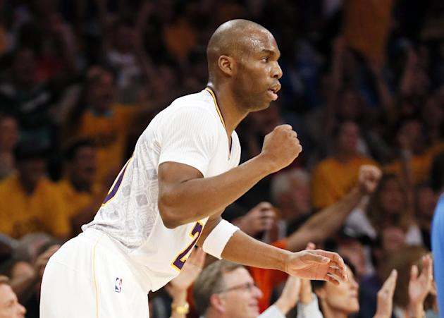 Los Angeles Lakers shooting guard Jodie Meeks celebrates after teammate Kent Bazemore made a three pointer during the second half of an NBA basketball game against Oklahoma City Thunder in Los Angeles