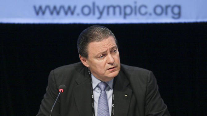 FILE - In this May 24, 2012 file photo, International Olympic Committee (IOC) Executive Board member Richard Carrion speaks with the media about an agreement between the IOC and the United States Olympic Committee at the SportAccord conference in Quebec city, Canada. Jacques Rogge, the Belgian surgeon who has led the Olympic body since 2001, steps down at the end of his term in September 2013. Although no one speaks openly yet about replacing him, the list of potential contenders is an open secret in IOC circles. With the election nine months away, the campaign is forging ahead behind the scenes without fanfare, policy platforms, debates - or any declared candidates for that matter. (AP Photo/The Canadian Press, Francis Vachon, File)