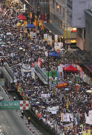 Tens of thousands of Hong Kong residents march in a …
