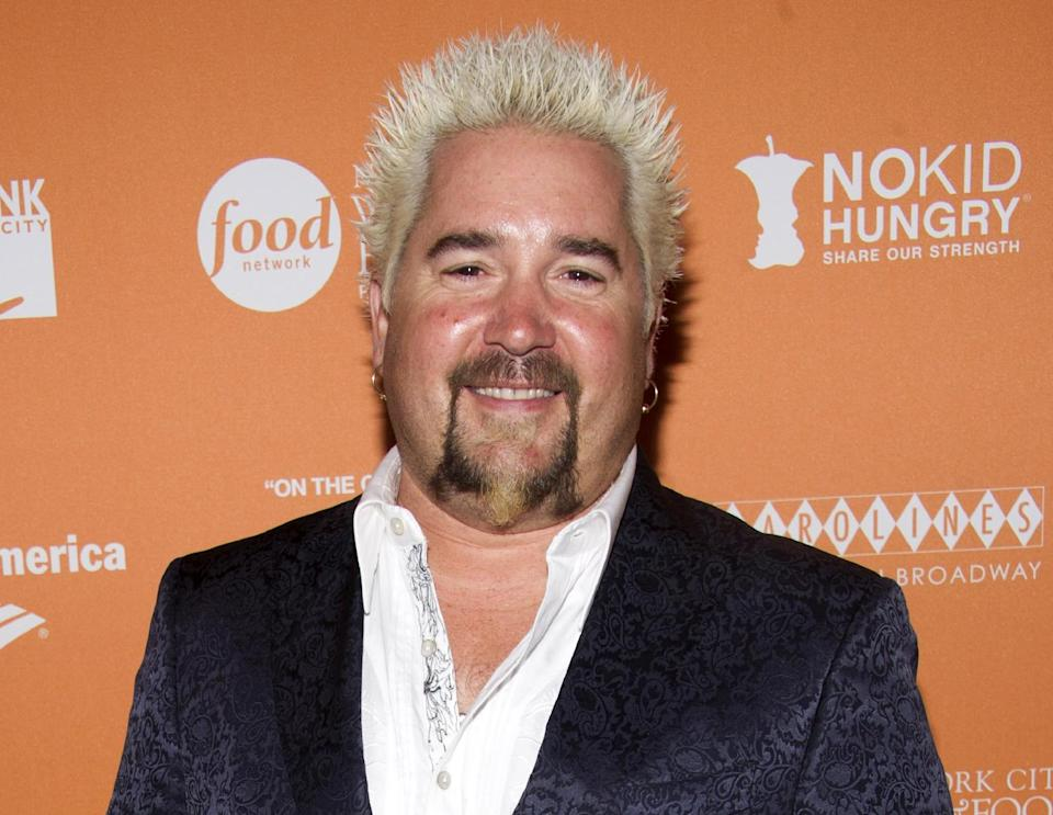 "This Oct. 11, 2012 file photo shows chef Guy Fieri at the  ""On The Chopping Block: A Roast of Anthony Bourdain"" in New York. (Photo by Charles Sykes/Invision/AP)"