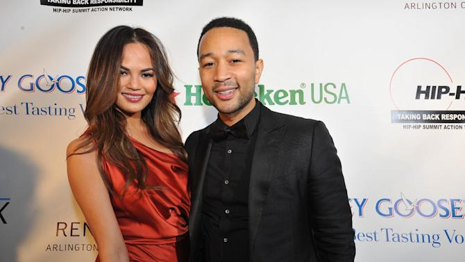 Christine Teigen, left, and John Legend are seen at the Hip-Hop Inaugural Ball on Sunday, Jan. 20, 2013 in Washington. (Photo by Larry French/Invision/AP)