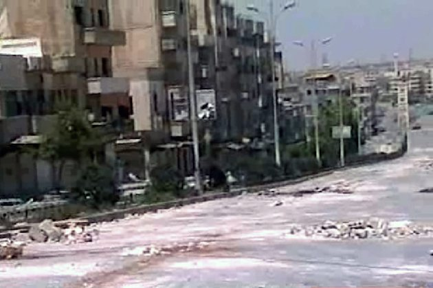 "In this image from television taken Thursday, Aug. 4, 2011 and released by the Syrian official news agency SANA, empty streets with debris are shown of what SANA describes as the Syrian army restoring ""security and stability"" to the central city of Hama, Syria. Syrian security forces pounded the city of Hama with tank shelling and opened fire on protesters who streamed into the streets across the country Friday Aug. 5, 2011 calling for the downfall of President Bashar Assad, killing at least four and wounding more than a dozen. (AP Photo/SANA) EDITORIAL USE ONLY"