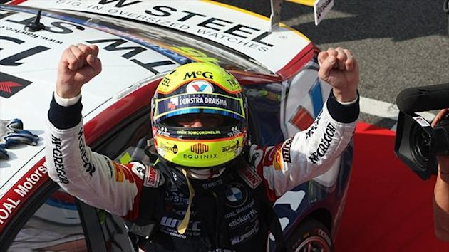 Tom Coronel celebrates a win in WTCC