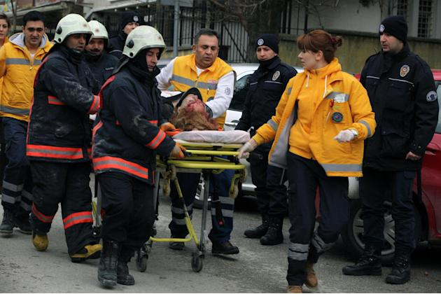 Medics carry an injured woman on a stretcher to an ambulance after a suspected suicide bomber detonated an explosive device at the entrance of the U.S. Embassy in the Turkish capital, Ankara, Turkey,
