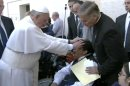 In this image made from video provided by APTN, Pope Francis lays his hands on the head of a young man on Sunday, May 19, 2013, after celebrating Mass in St. Peter�s Square. The young man heaved deeply a half-dozen times, convulsed and shook, and then slumped in his wheelchair as Francis prayed over him. The television station of the Italian bishops� conference said it had surveyed exorcists, who agreed Francis either performed an exorcism or a prayer to free the man from the devil. The Vatican was more cautious Tuesday, saying Francis �didn�t intend to perform any exorcism. But as he often does for the sick or suffering, he simply intended to pray for someone.� (AP Photo/APTN)