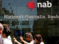 A National Australia Bank branch in Sydney. National Australia Bank posted a 22 percent slump in full-year net profit Wednesday as millions of dollars in costs from its struggling British operations weighed on the bottom line