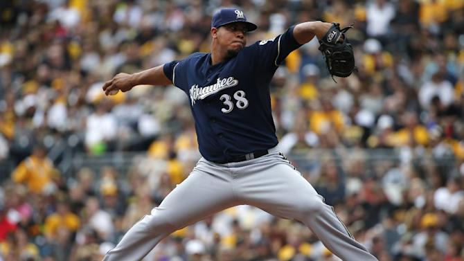 Milwaukee Brewers starting pitcher Wily Peralta (38) delivers during the first inning of a baseball game against the Pittsburgh Pirates in Pittsburgh, Sunday, Sept. 21, 2014. (AP Photo/Gene J. Puskar)