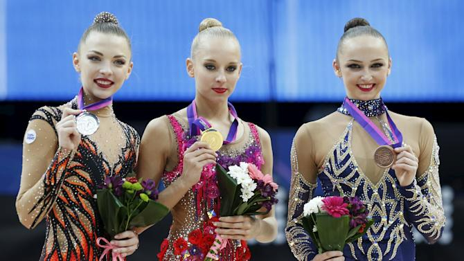 Russia's Kudryavtseva, Belarus' Staniouta and Azerbaijan's Durunda pose for a photo after the awards ceremony in the individual final programme at the 31st European Rhythmic Gymnastics Championships in Minsk