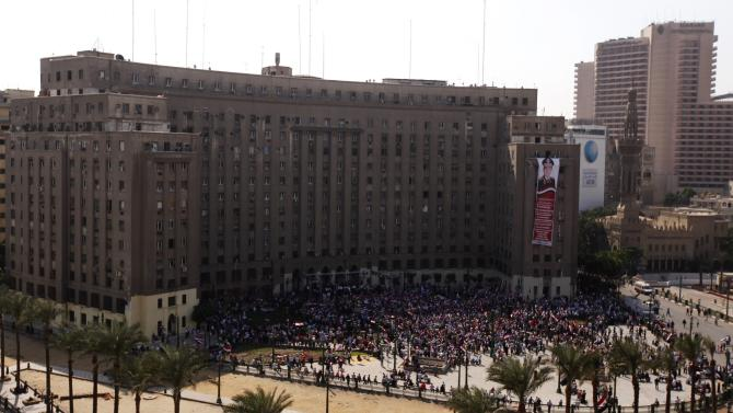 People gather in Tahrir square to celebrate the anniversary of an attack on Israeli forces during the 1973 war, in Cairo